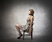 Woman tied in chair